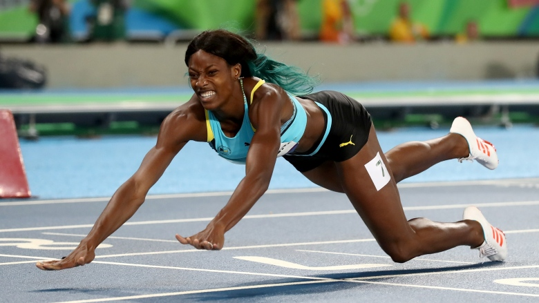 shaunae-miller-dives for gold Thabi Nyoni